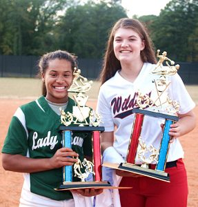 Arabia Mountain pitcher Kayla Phillips (left) won the Red MVP Award while Dunwoody's Megan Pierce captured the Blue MVP Award. The Red defeated the Blue 15-8. (Photo by Mark Brock)