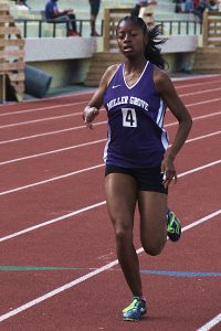 Miller Grove's Emoni Coleman won the girls' 1600 meter run for the second consecutive season to help pace defending champ Miller Grove's 50 point tally on the first day of the DCSD Track and Field Championships.