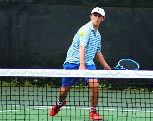Chamblee's Allen Howell moves towards the net during his long three-set match at No. 1 singles on Wednesday. (Photo by Mark Brock)