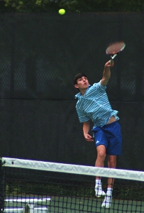 Chamblee's Jake Busch serves during his No. 2 doubles match with partner Esaan Agawal. The pair won 6-1, 6-1 at No. 2 doubles. (Photo by Mark Brock)