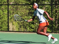 Tucker's Autumn Clemons is on the move during her No. 1 singles win against Evans.