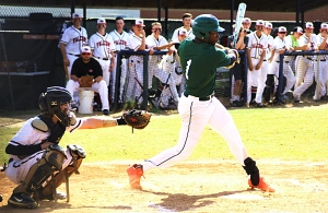 Arabia Mountain's Silas Butler puts the ball in play during Game 3 of the Rams' Class 5A playoff series against Flowery Branch. (Photo by Mark Brock)