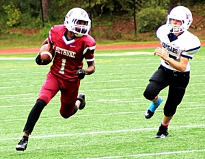 Bethune's Bernard Mack (1) gets past Henderson's Luke Chilton (25) on the way to a 47-yard punt return for a touchdown. (Photo by Mark Brock)