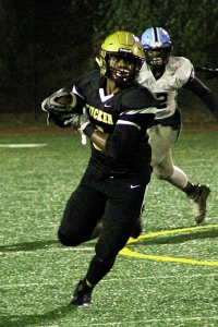 Tucker senior running back Donnie Harris had 81 yards rushing and a touchdown in the Tigers' 57-7 win over Mt. Zion-Jonesboro. (Photo by Mark Brock)