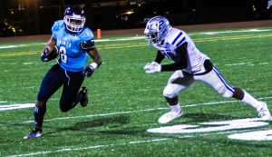 """Cedar Grove running back Robert """"Pop"""" Jones (8) rushed for 256 yards and two touchdowns to lead the Saints to a 30-6 win over Pierce County to advance to the Class 3A state finals for the second time in three years. (Photo by Mark Brock)"""