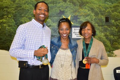 Gail Devers poses with principal and AP