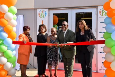Dr. Green, board member, and employees cut ribbon