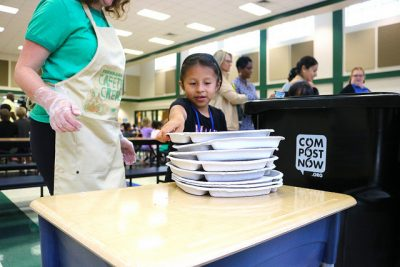 student places tray on table