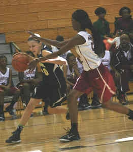 Renfroe's Lily Kostka (left) dribbles against Champion's KeAundrea Middlerbrooks (right).