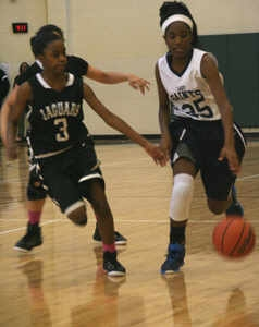 Stephenson's Kassidy Broussard (3) defends against Cedar Grove's Natoria Hill (25).