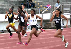 Chamblee junior Venida Fagan (4) holds off Miller Grove's Tiara Williams (3) and Cierra Jones (5) for the 100M Dash gold at the 2015 DCSD Championships. (Photo by Mark Brock)