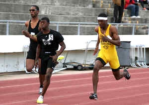 Southwest DeKalb's Terryon Conwell (yellow) pulls even with McNair's Marcellus Boykins (5) on the way to the 100M Dash gold at the 2015 DCSD Championships. (Photo by Mark Brock)