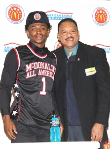 Local McDonald's owner John Hurd (right) presented Miller Grove's Alterique Gilbert with his McDonald's All-American jersey and cap. (Photo by Mark Brock)