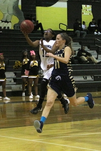 Lithonia's Kalyn Geer (10) goes up for a shot in the lane against St. Pius' Hannah Jones (11). (Photo by Mark Brock)