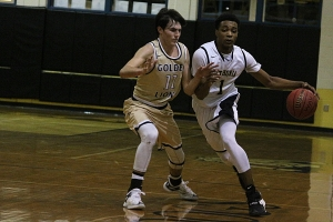 Lithonia's Rodney Chatman (1) drives against St. Pius' Christian Merrill (11) during the key Region 6-4A battle between No. 2 Lithonia and No. 3 St. Pius.  (Photo by Mark Brock)