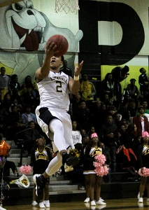 Lithonia's Tyheem Freeman goes in for an easy bucket against St. Pius. (Photo by Mark Brock)