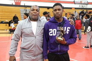 Miller Grove's Gary Freeman (right) was named the Venable Best Wrestler Award winner after winning the 152 pound division. Joining Freeman is his coach William Wright (left). (Photo by Mark Brock)