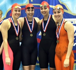 The Dunwoody girls' relay team of (l-r) Allie Reiter, Kaleigh McGrady, Laura Spratling and Hannah Robison won both the 200 yard and 400 yard freestyle relays giving Dunwoody its first state relay gold since 1987. (Photo Courtesy of Dunwoody High School)