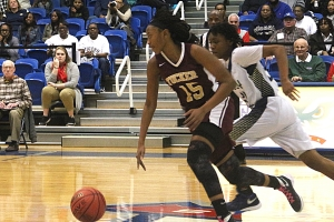 Tucker's Bria Bass (15) races up court against Douglas Co. The Lady Tigers won and advanced to the Class 6A Championship in Macon. (Photo by Mark Brock)