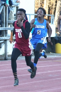 Champion's Jordan Barrow (left) pulls away from Stephenson's  Stephenson's DeQuandre Moore in the 4x100 meter relay. Barrow set the long jump record and swept the 100 and 200 meter dashes to earn MVP honors. (Photo by Mark Brock)