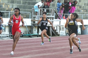 Tucker freshman Kaylah Lumsden (far right)  swept the 100 and 200 meter dashes in the Region 2-6A Track Championships. (Photo by Mark Brock)