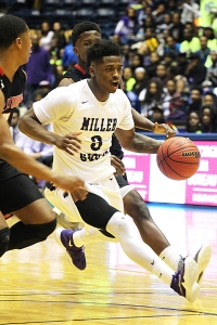 Miller Grove's Alterique Gilbert drives against Allatoona in the Wolverine's 50-48 state championship victory. (Photo by Janette Brock)