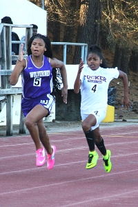 Tucker's Jessica Shelley (right) pulls past Miller Grove's Anjelica Frederick on the way to sweeping the 100 and 200 meter dashes to earn MVP honors. (Photo by Mark Brock)