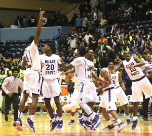 Miller Grove's Raylon Richardson holds a No. 1 in the air as he and his Wolverine teammates celebrate the Class 5A boys' state championship victory over Allatoona. (Photo by Mark Brock)