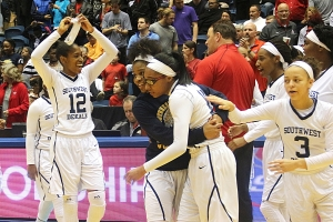 Chantz Cherry (middle) and a Southwest DeKalb teammate celebrate the state title. (Photo by Mark Brock)