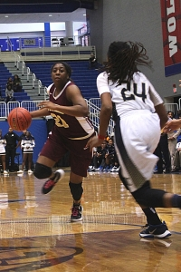 Tucker's Kierra Johnson-Graham drives against Douglas County. She and her teammates try to dethrone two-time defending champion McEachern in Saturday's Class 6A state championship game. (Photo by Janette Brock)