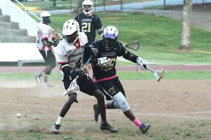 Druid Hills' Willie Jordan (left) and Lakeside's James Jackson (right) battle each other for a ground ball. (Photo by Mark Brock)