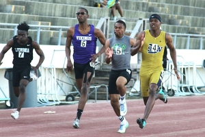 Arabia Mountain's Priest Foust (center) won the 100 meter dash and came in second in the 200 meter dash at the Region 6-4A boys' track meet.  (Photo by Mark Brock)