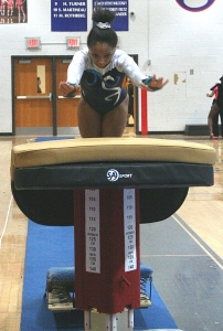 Redan's Mya Hemingway won the 2015 DCSD Gymnastics Championships gold in the vault. She qualified and will compete in the uneven parallel bars at the 2016 State Meet. (Photo by Mark Brock)