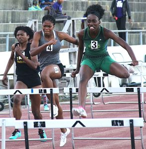 Arabia Mountain's Destinee Rocker (far right) captured gold in the Class 4A girls' 100 meter hurdles.  (Photo  by Mark Brock)
