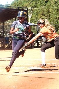 Arabia Mountain's Dyamond Brown beats the play at the plate on a wild pitch to score from third. Brown also had a diving catch to seal a 9-8 game 2 win to clinch the playoff series for the Rams.  (Photo by Mark Brock)