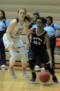 Cedar Grove's Mikaysha Lemon (right) drives the baseline against Pace. (Photo by Mark Brock)