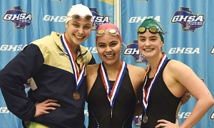 Chamblee's Jade Foelske (middle) won two gold medals at the 2018 GHSA Class 4A-5A Swimming and Diving State meet to become a four-time state championship gold medal winner. (Photo courtesy of Gib Stanfield)