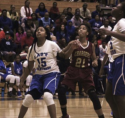 Chapel Hill's Genesis Reid (15) and Champion's Madison Smith (21) battle for rebounding position on a free throw during the girls' title game.