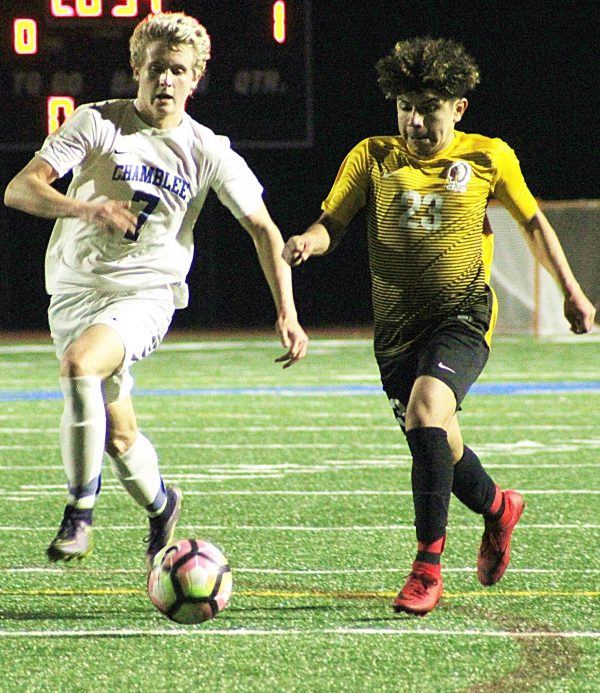 Cross Keys' Anthony Maldonado (23) gets past Chamblee's Cannon Statigos (7) on the way to a score in the Indians' 9-1 win at North DeKalb Stadium. (Photo by Mark Brock)