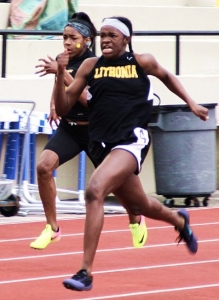 Lithonia's Rusanek Tyler-Thompson set the 100 meter dash record of 11.92. (Photo by Mark Brock)