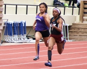 Martin Luther King Jr.'s Kayla Hunt (right) battles Miller Grove's Angelica Frederick (left)