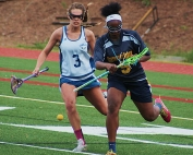 Chamblee's Viviana Austin-Knab (3) and Southwest DeKalb's Jayla Kimbrough (9) battle for a loose ball during Southwest DeKalb's 19-6 girls' lacrosse region win on Wednesday.