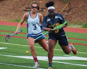 Chamblee's Viviana Austin-Knab (3) and Southwest DeKalb's Jayla Kimbrough (9) battle for a loose ball during Southwest DeKalb's 19-6 girls' lacrosse region win on Wednesday. (Photo by Mark Brock)