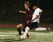 Cross Keys' Eduardo Dimas (white jersey) charges past a defender on the way to the Indians' only goal in a 2-1 Class 5A playoff loss.