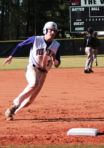 Lakeside's Charlie Ludwick rounds third base on the way to score the first of his three runs against Stephenson. (Photo by Mark Brock)