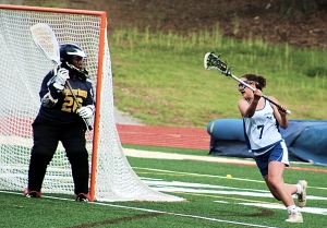 Southwest DeKalb goalie Brittney Buchanan (26) prepares for a shot by Chamblee's Kirby Guerrero (7). (Photo by Mark Brock)