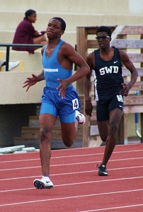 Stephenson's Bradley Favors (left) pulls away from Southwest DeKalb's Jalon Kimbrough to win the 400 meter dash. (Photo by Mark Brock)