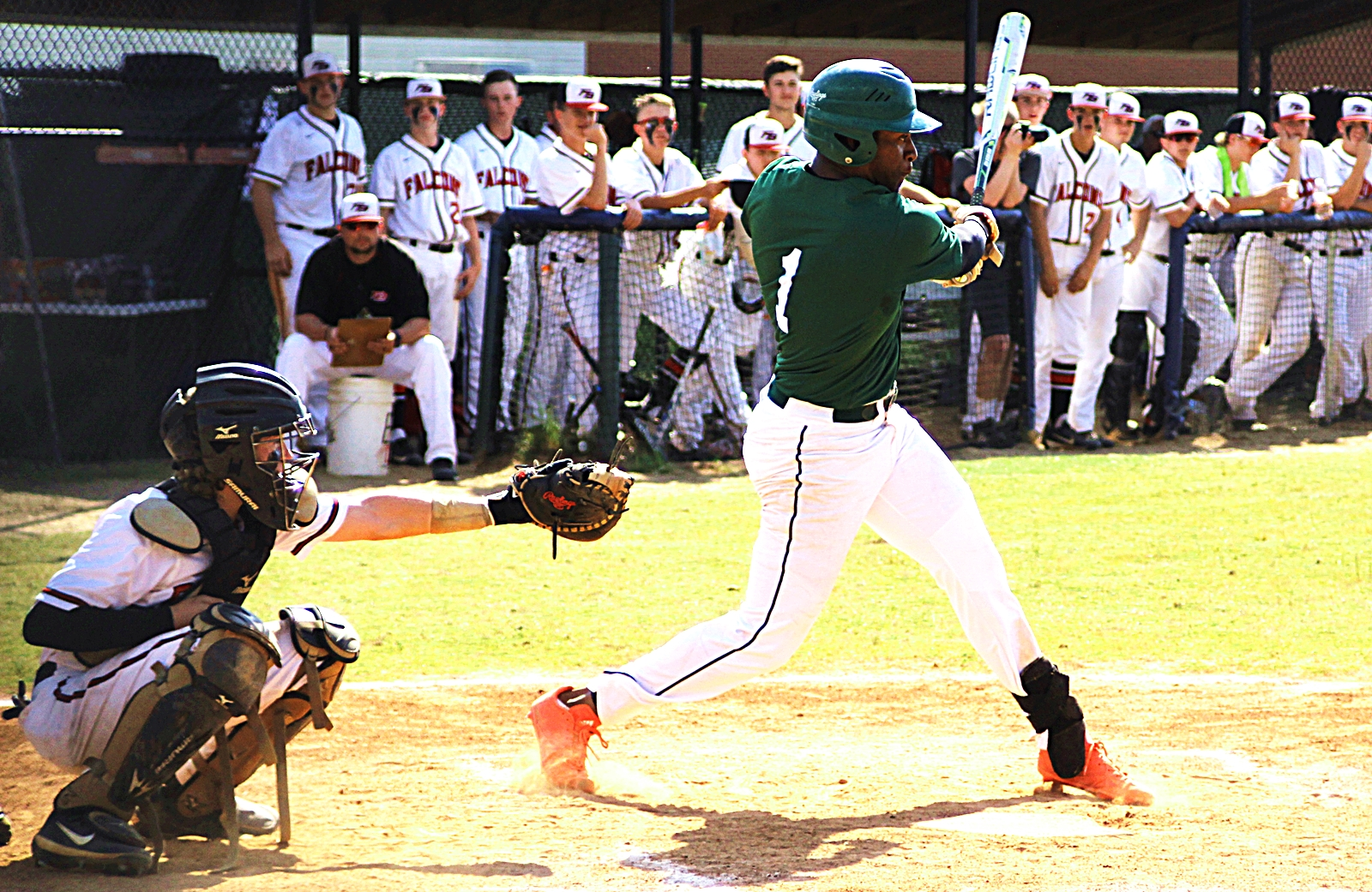 Arabia Mountain's Silas Butler puts the ball in play during Game 3 of the Rams' Class 5A playoff series against Flowery Branch.