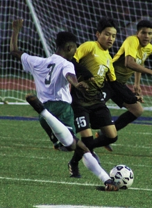 Clarkston's Tuyisenge Israel (3) and Cross Keys' Miguel Hernandez (15) face off one last time in 2018 on opposite sides of the 2018 DCSD Boys' All-Star Soccer game. (Photo by Mark Brock)