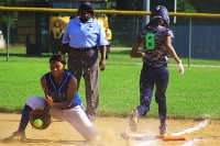 Stephenson first baseman Ja'Nae Wray gets low to block a throw as Arabia Mountain's Aleaya Thornton (8) beats out the throw. (Photo by Mark Brock)